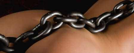 Large heavy chained on a girls body