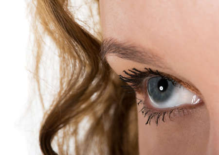 Close up of a beautiful girls blue eye Stock Photo