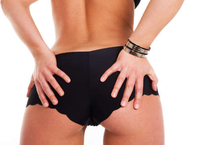 View of a girls butt seen against white background Stock Photo - 4568823