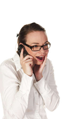 Beautiful girl getting good news on the phone, seen against white background Stock Photo - 7580112