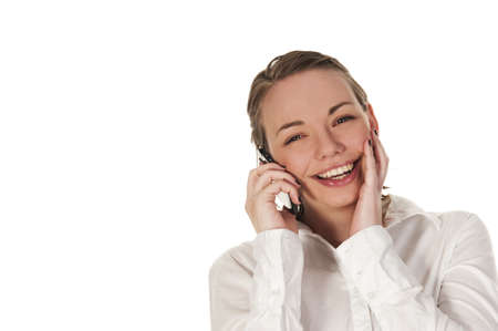 Happy girl on the phone, seen against white background photo