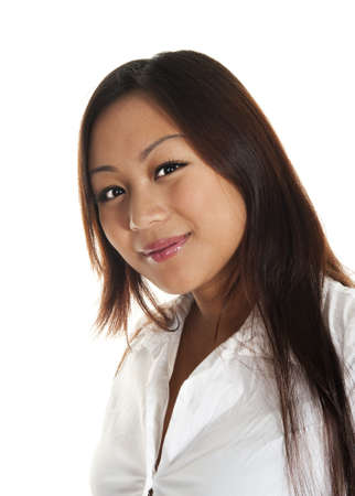 Beautiful asian girl smiling, seen against white background