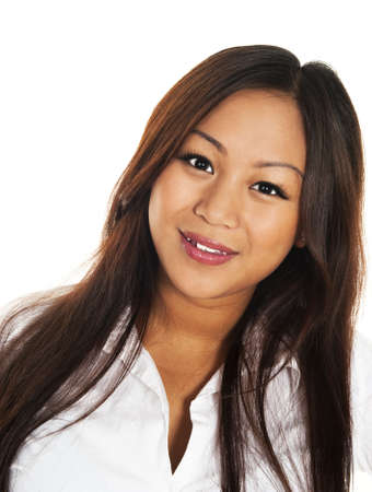 Beautiful smiling asian girl, seen against white background Stock Photo