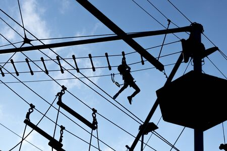 humane: Person climbing on high ropes