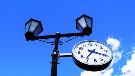 The most widespread measuring device - hours on a background of the bright dark blue sky.                     photo