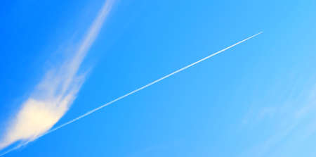 emphasizes: The jet military plane gains height, on a background of the blue sky. The form of easy clouds emphasizes effect of speed.