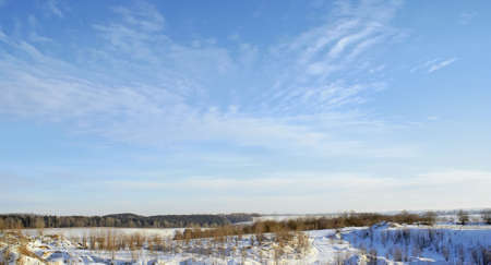 Winter landscape, snow field, beautiful relief from hills and ravines, light, blue, cold sky.  photo