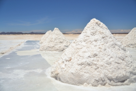 Heap of sea salt in a Bolivian salt flat prepared for harvest photo