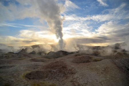 erupting geyser of steam with sulfur deposits, Bolivia photo