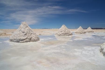 briny: Heap of sea salt in a Bolivian salt flat prepared for harvest