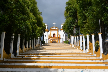 cristobal: A Christian Catholic chapel on a hill with colorful steps in San Cristobal de las Casas, Chiapas, Mexico