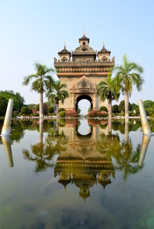 far eastern: Patuxai arch monument reflecting, Laotian arc de triomphe Vientiane, the Capital of Laos. Stock Photo