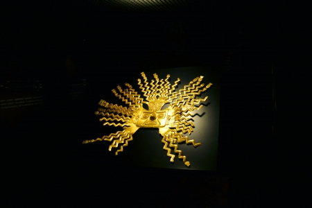 past civilizations: A Golden inca mask in a museum in Quit, Ecuador with black background