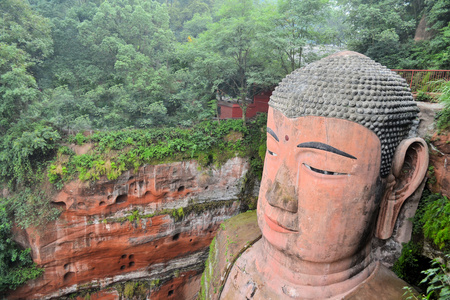 The Leshan Giant Buddha, the largest stone Buddha in the world and it is by far the tallest pre-modern statue in the world in Mount Emei, Sichuan, China