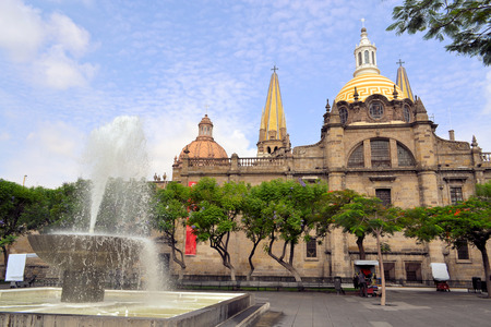 The old cathedral with yellow roofs in the historical centre of Guadalajara, Jalisco, Mexico Stock Photo