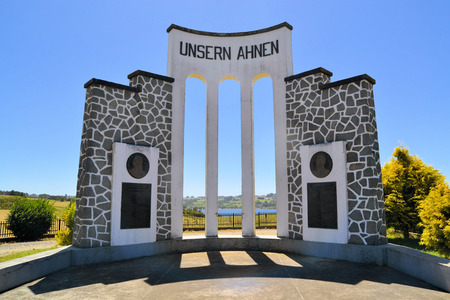 ancestors: Monument for German immigrants in Chile near lake Llanquihue between Frutillar and Puerto Varas saying  for our ancestors  in German  Unsern Ahnen  Stock Photo