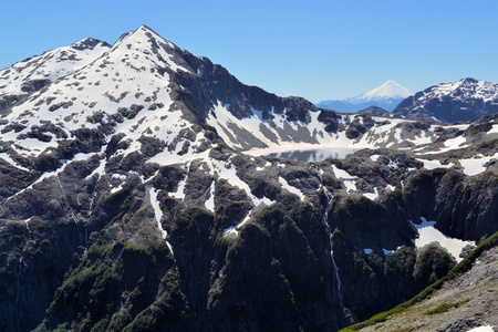 los glaciares: Beautiful mountain landscape from Arco Iris peak at Cochamo National Park looking at a glacier lake with volcano Osorno in the far back