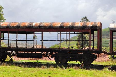 Old train car in the middle of a tea plantation nature landscape, Sri Lanka photo