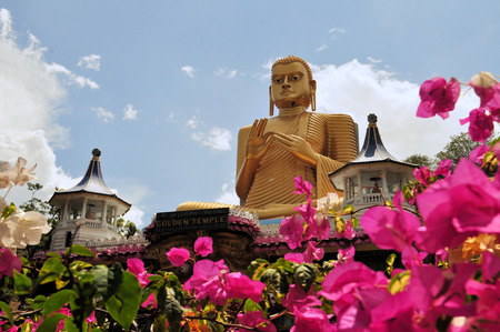 buddhist temple: Golden Buddha at the Golden Temple of Dambulla Cave Temple, Sri Lanka.