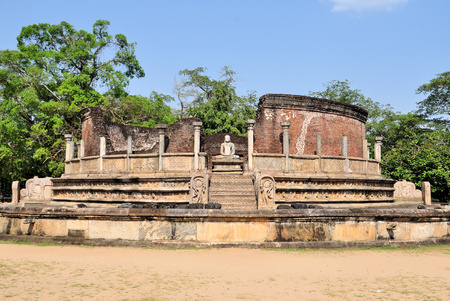 Vatadage in ancient city of Polonnaruwa, Sri Lanka. A Vatadage is an ancient monument and it was built for the protection of a stupa. photo