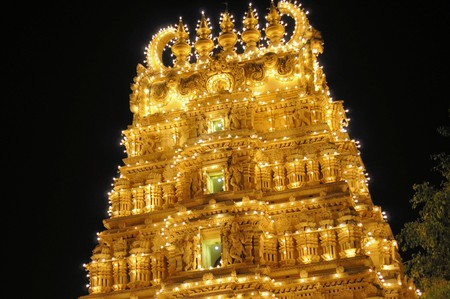 This temple as part of the ancient Mysore Palace in India is illuminated by thousands of lightbulbs every night photo