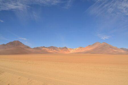unpaved road: Lonely unpaved road trough colorful Salvador Dali Desert in Altiplano, Bolivia