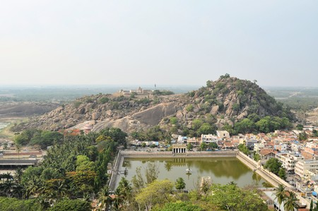 temple tank: Traditional Hindu temple in lush landscape and green water tank in Shravanabelagola, India