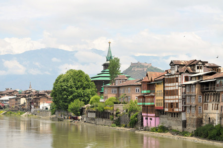 house float on water: Mosques along the Jahelum river in Srinagar old town, Kashmir, India