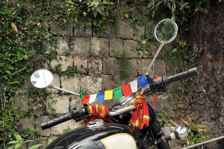 supposed: Tibetan Buddhist prayer flags are supposed to protect a motorbike in Dharamsala, Himachal Pradesch
