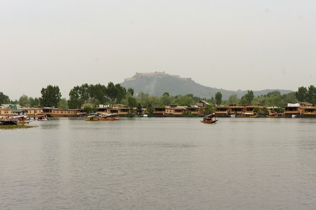accommodate: House boats on the dal lake are a traditional home in Srinagar, Kashmir and are commonly used to accommodate tourists.
