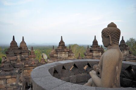 Buddha in giant Buddhist Borobudur Temple  monolith in the Prambanan Plain near Yogyakarta, Java, Indonesia. photo