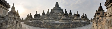Panorama of giant Buddhist Borobudur Temple  monolith in the Prambanan Plain near Yogyakarta, Java, Indonesia. photo