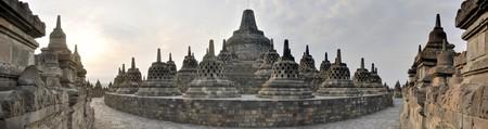 Panorama of giant Buddhist Borobudur Temple  monolith in the Prambanan Plain near Yogyakarta, Java, Indonesia. photo