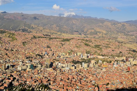 facto: The city of La Paz high in the Andes Mountains is the de facto capitol of Bolivia Editorial