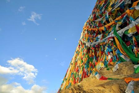 lamaism: Tibetan Buddhist prayer flags are bound around a stupa in Lhasa, Tibet