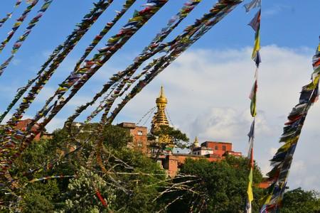 lamaism: Swayambunath Stupa Monkey Temple with Tibetan Buddhist prayer flags in Kathmandu, Nepal Stock Photo