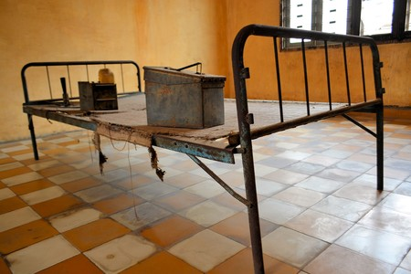 phen: Res Khmer Torture Bed in Prison Cell of Tuol Sleng in Pnomh Penh Cambodia