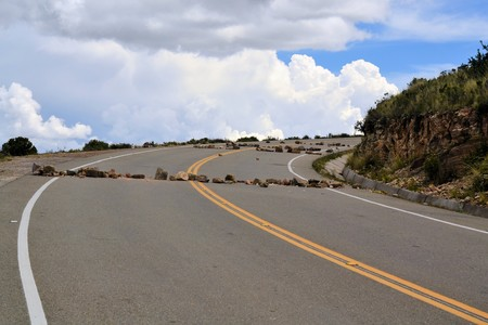 land slide: Road at lake Titicaca is blocked by rock and debris for political reasons on the altiplano near Copacabana, Bolivia