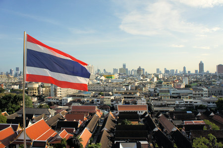 Skyline of the Cityscape with Thai flag in urban Bangkok,capital of Thailand photo