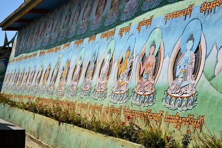 depictions: Colorful depictions of Buddha on the outside of a Buddhist temple near Singalila, Nepal