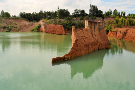 an excavation: popular quarry pond for swimming and outdoor life, lake at excavation site in Opkhan national park near Chiang Mai, Thailand