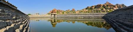 karnataka culture: Ancient water pool and temple at Krishna market, Hampi, Karnataka state, India Stock Photo