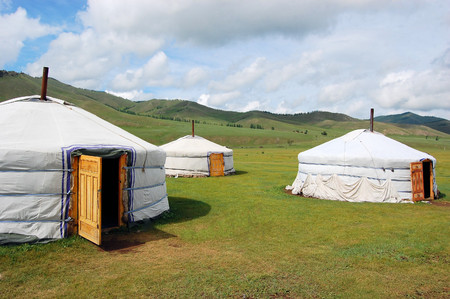 mongol: Little village of nomadic Yurt camp in the Mongolian Steppe at Terelj National Park