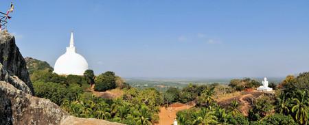 buddhist stupa: Buddhist stupa and Buddha on a hilltop at Mihintale Monastery, Sri Lanka