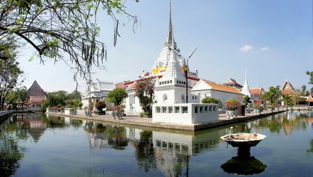 lad: Thai Buddhist temple Wat Khan Lad is surrounded by a pond of water in Bangkok, Thailand
