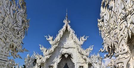 unconventional: Beautiful ornate white temple located in Chiang Rai northern Thailand. Wat Rong Khun - White Temple, is a contemporary unconventional Buddhist temple.