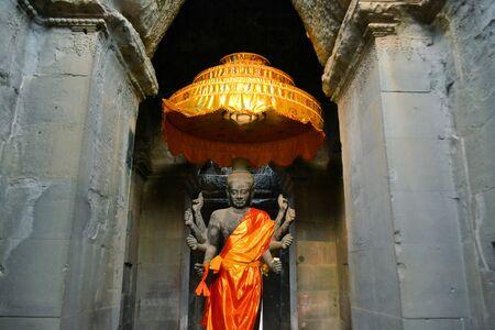 Ancient Buddhist Altar with Buddha statue at Angkor Wat, Cambodia