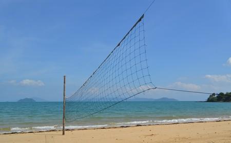 Volleyball net on empty beach at Ko Phayam island, Thailand photo