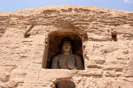 unesco world cultural heritage: Yungang Grottoes Buddha caves is a UNESCO World cultural heritage site near Datong, Shanxi Province. It is cave 20. Buddha is 13.7 metres high. Stock Photo