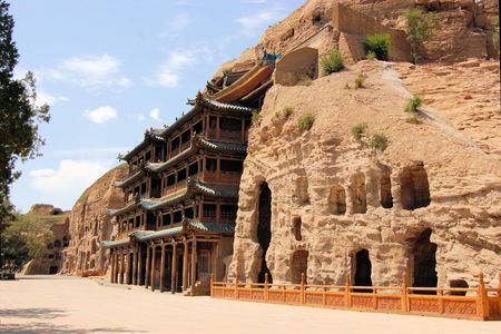 metres: Yungang Grottoes Buddha caves    near Datong, Shanxi Province. It is cave 20. Buddha is 13.7 metres high. Stock Photo